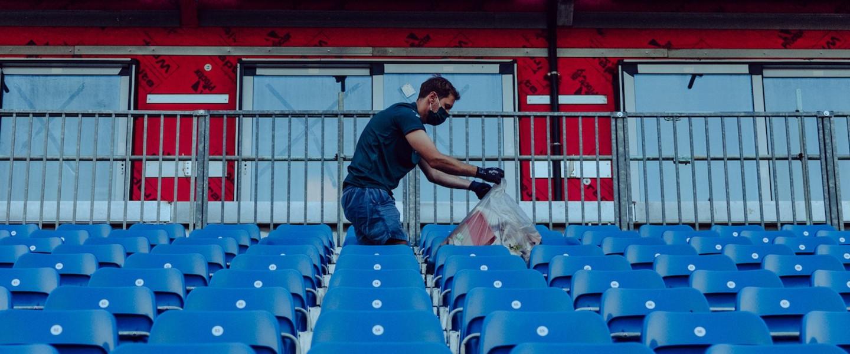 Sebastian picks up litter following the British Grand Prix
