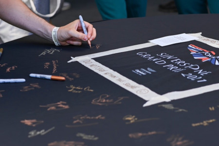 Guests sign the AMR car cover
