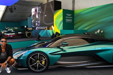 TV Presenter Reggie Yates poses with the Aston Martin Valhalla