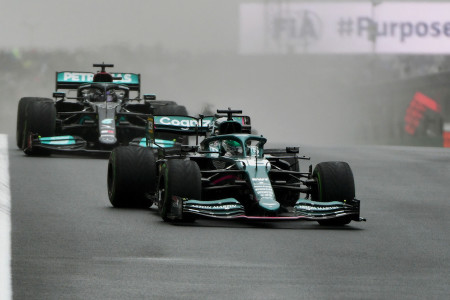 Lance fends off Lewis Hamilton during the opening stint of the race