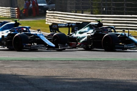 Sebastian makes a move on Esteban Ocon in the Grand Prix
