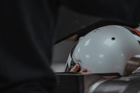 Sebastian Vettel undergoes his seat fitting