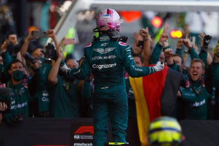 Sebastian celebrates the podium with the team