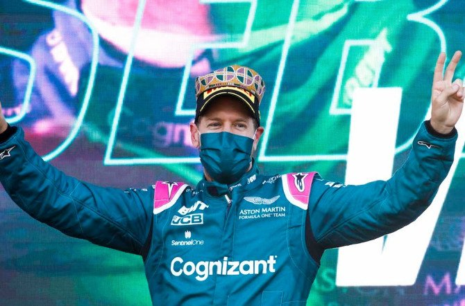 Sebastian soaks up the atmosphere on the Baku podium